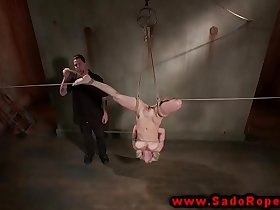 Bound suspended and gagged bdsm whore getting dildo fucked