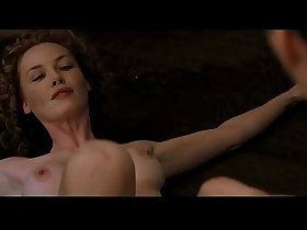 Connie Nielsen Charlize Theron in Devil's Advocate 1997